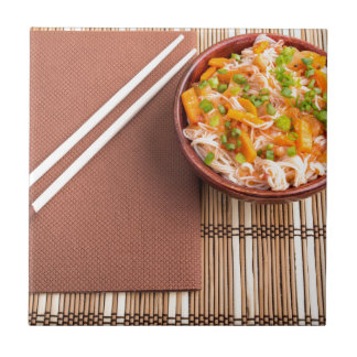 Top view of an Asian dish of rice noodle Tile