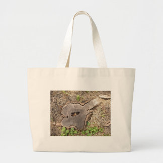 Top view of an old stump of cut tree cracked large tote bag