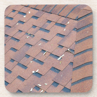 Top view of brown roof shingles coaster