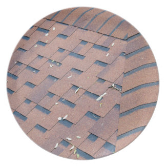 Top view of brown roof shingles melamine plate