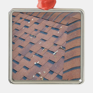 Top view of brown roof shingles metal ornament