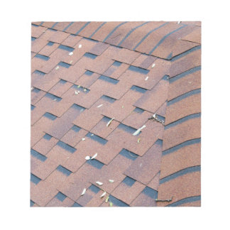 Top view of brown roof shingles note pad
