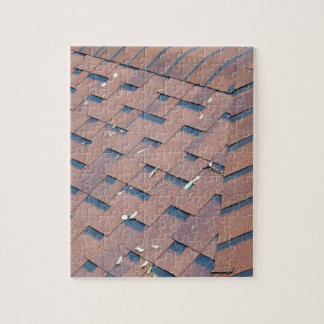 Top view of brown roof shingles puzzle