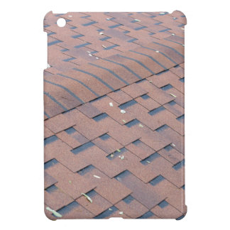 Top view of brown roof shingles with a few fallen case for the iPad mini
