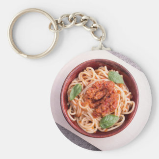 Top view of cooked spaghetti with tomato relish keychain