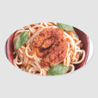 Top view of cooked spaghetti with tomato relish oval sticker