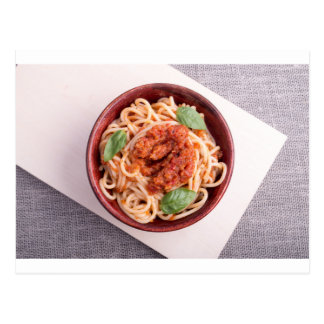 Top view of cooked spaghetti with tomato relish postcard