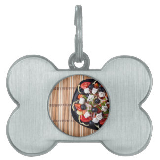 Top view of fresh vegetarian salad on a black pet name tag