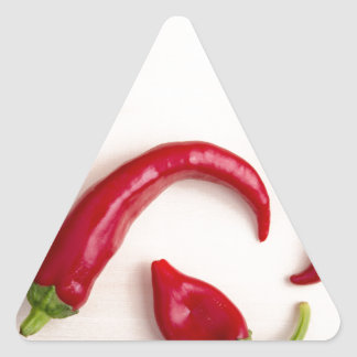 Top view of hot chili peppers triangle sticker