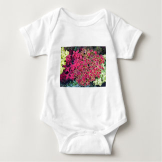 Top view of multicolored and colorful flower bed tshirts