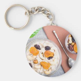 Top view of oatmeal porridge with raisins, cashews keychain