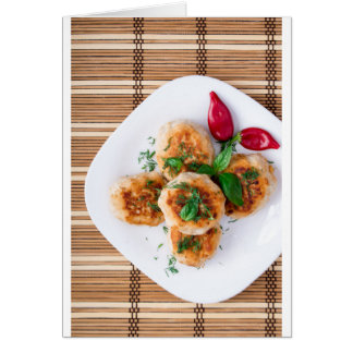 Top view of the fried meatballs with red pepper card