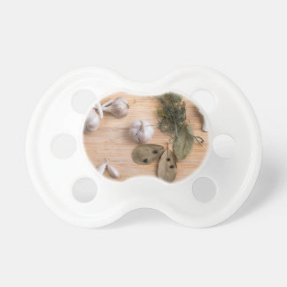 Top view of the garlic and dried spices pacifier