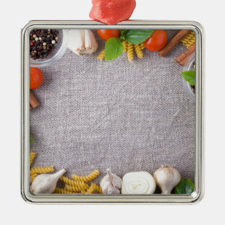 Top view of the ingredients for a meal metal ornament