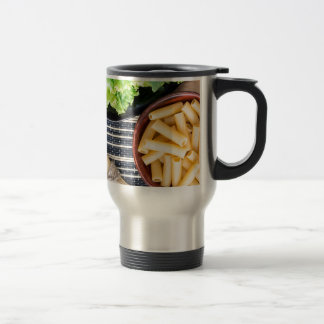 Top view of the ingredients for cooking food travel mug