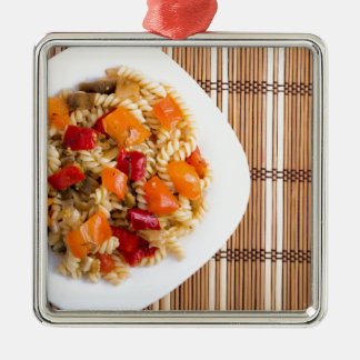 Top view of the Italian pasta on wooden background Metal Ornament