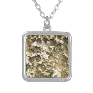 Top view of the natural background closeup square pendant necklace