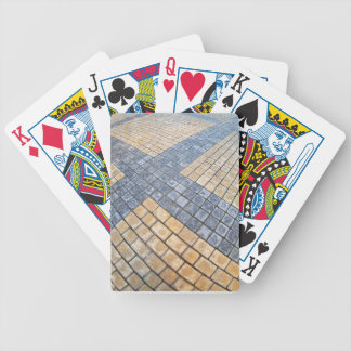 Top view of the pavement of rectangular stones bicycle playing cards