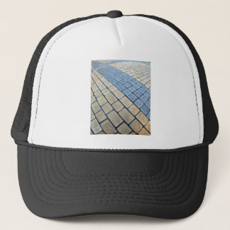 Top view of the pavement of rectangular stones trucker hat