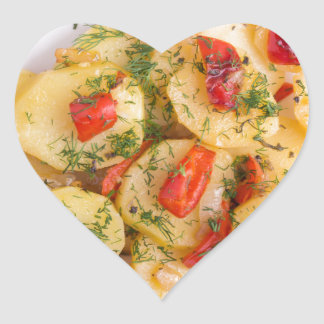 Top view of the pieces of potato stew with vegetab heart sticker
