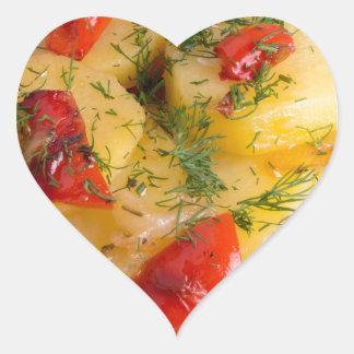 Top view of the vegetarian dish of organic potato heart sticker