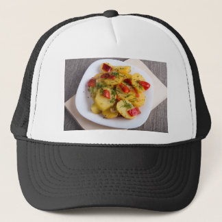 Top view of the vegetarian dish of organic trucker hat