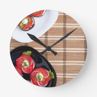 Top view of the vegetarian dishes stewed eggplant round clock