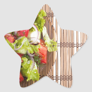 Top view of vegetarian salad from fresh vegetables star sticker
