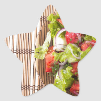 Top view of vegetarian salad on a bamboo mat star sticker