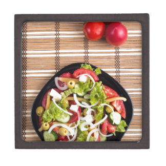 Top view on a fresh vegetable salad with natural gift box