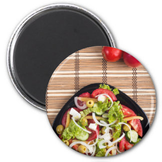 Top view on a fresh vegetable salad with natural magnet