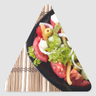 Top view on a healthy and natural vegetable salad triangle sticker