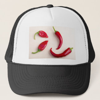 Top view on a hot red chili peppers trucker hat