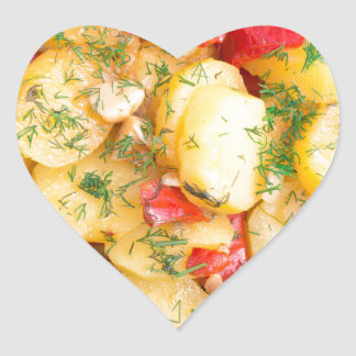 Top view on a stew of potatoes with pepper heart sticker