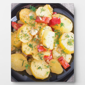 Top view on a stew of potatoes with pepper plaque