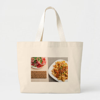 Top view on Cavatappi Pasta on textile background Large Tote Bag