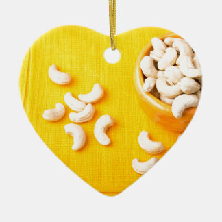 Top view on natural and healthy cashews ceramic ornament