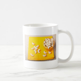 Top view on natural and healthy cashews coffee mug