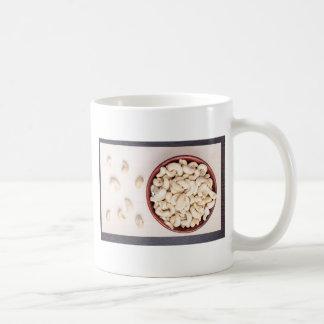 Top view on raw cashew nuts for vegetarian food coffee mug