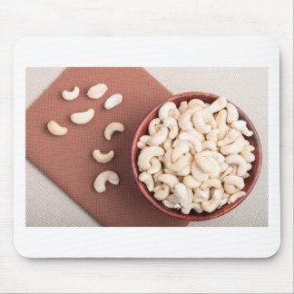 Top view on raw cashew nuts for vegetarian food mouse pad