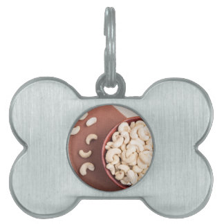 Top view on raw cashew nuts for vegetarian food pet tag