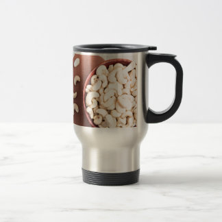 Top view on raw cashew nuts for vegetarian food travel mug