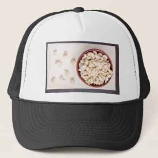Top view on raw cashew nuts for vegetarian food trucker hat