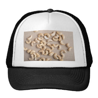 Top view on raw cashew nuts scattered on the table trucker hat