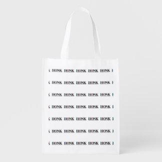 Toque la bocina si usted no está votando por bolsas para la compra