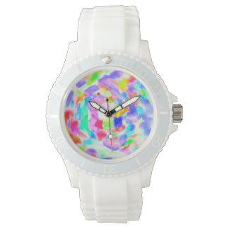 ¡Torbellino de colores dentro de un reloj blanco!