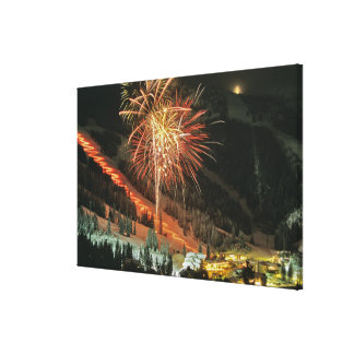 Torchlight parade and fireworks during Winter Canvas Print