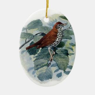 Tordo de madera en una ramita adorno navideño ovalado de cerámica