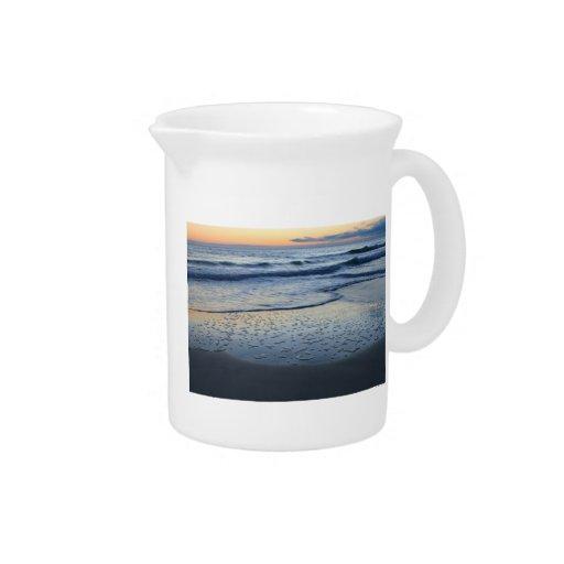 tormenta del claro en la playa jarra de beber