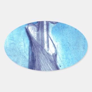 Torn by the blue sky oval sticker